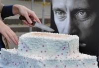 An activist of 'Army of Putin' cuts a birthday cake in honor of Vladimir Putin, Moscow, October 7, 2011