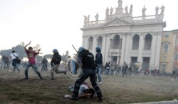 Police clash with protesters in front of the St. John in Lateran basilica, Rome, Oct. 15, 2011.