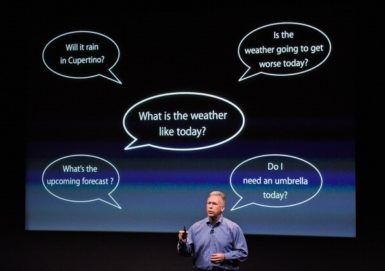 Apple's Senior Vice President of marketing Phil Schiller demonstrating features of Siri, Cuptertino, California, October 4, 2011 in Cupertino, California.