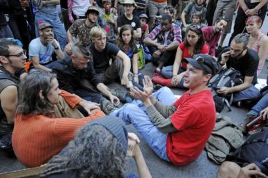 An instructor demonstrating how to break free of plastic hand restraints at the Occupy Wall Street occupation of Zuccotti Park, New York, October 9, 2011