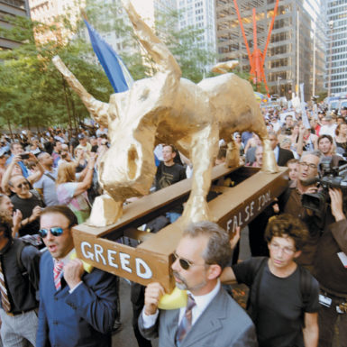 Clergymen carrying a papier-mâché effigy of the biblical golden calf to the Occupy Wall Street camp in Zuccotti Park, New York City, October 9, 2011