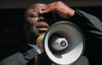 Morgan Tsvangirai speaking to immigrants from Zimbabwe who had been attacked by South Africans, Reiger Park, South Africa, May 2008