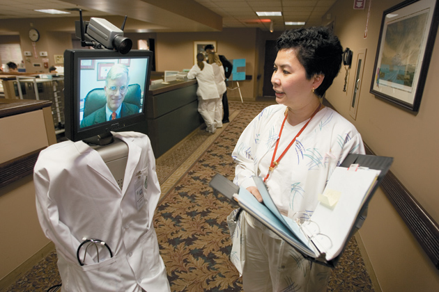 A nurse consulting a doctor via Mr. Rounder the Robot, Hackensack University Medical Center, Hackensack, New Jersey, 2005