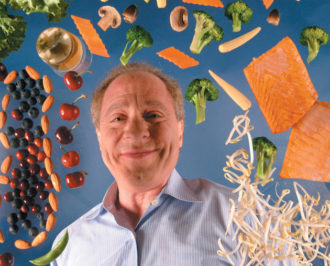 Ray Kurzweil, surrounded by some of the foods he recommends for living a longer life, November 2004