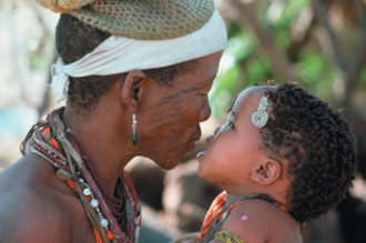 A !Kung grandmother and grandchild, Namibia