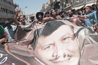Protesters carrying a portrait of King Abdullah II, Amman, Jordan, July 15, 2011