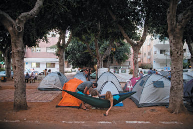 An Israeli family in a camp set up as part of a protest against the high cost of housing, Tel Aviv, Israel, July 23, 2011
