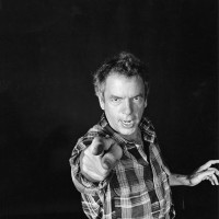 Spalding Gray performing Swimming to Cambodia, New York City, 1986