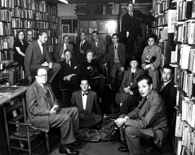 Attending a reception for Edith and Osbert Sitwell (seated at center) are, clockwise from top right, W.H. Auden, Elizabeth Bishop, Marianne Moore, Delmore Schwartz, Randall Jarrell, Charles Henri Ford, William Rose Benet, Stephen Spender, Marya Zaturenska, Horace Gregory, Tennessee Williams, Richard Eberhart, Gore Vidal, and Jose Garcia Villa, Gotham Book Mart, New York City, November 9, 1948