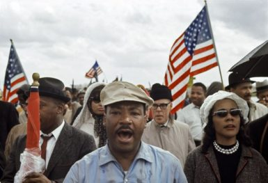 Dr. Martin Luther King leading the march from Selma to Montgomery