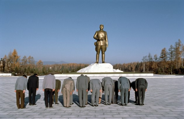 Local party officials paying respects to a statue of Kim II Sung as a young military leader at Mt. Paekdu, Pyongyang, 1982
