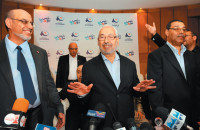 Hamadi Jebali, general secretary of Ennahda (the Renaissance Party), its leader Rached Ghannouchi, and party member Abdehhamid Jilassi at a press conference five days after Ennahda's victory in Tunisian elections, Tunis, October 28, 2011
