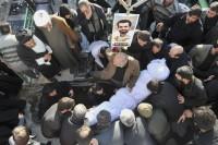 The shrouded body of assassinated chemistry expert Mostafa Ahmadi Roshan, who had been a director of the Natanz uranium enrichment facility, Tehran, January 13, 2012