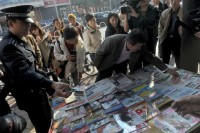 Chinese police raiding an unlicensed newsstand selling banned publications, Beijing, October 18, 2011
