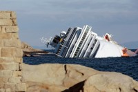 The cruise ship Costa Concordia leans on its side on January 17, 2012, after running aground on the Tuscan island of Giglio, Italy