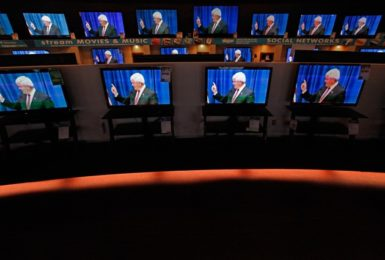 Dozens of televisions display a political ad showing Newt Gingrich, Urbandale, Iowa, December 27, 2011