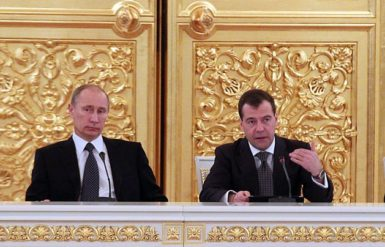 Russian Prime Minister Vladimir Putin and President Dmitry Medvedev attend the session of the State Council in the Kremlin in Moscow, December 26, 2011