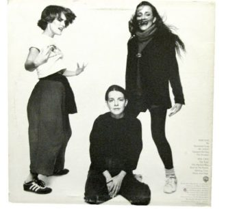 Terre (left), Maggie (middle), and Suzzy (right) on the back cover of their first album,