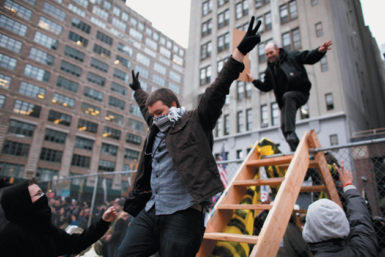 Occupy Wall Street protesters entering a vacant lot on Canal Street and Sixth Avenue owned by Trinity Church, New York City, December 17, 2011