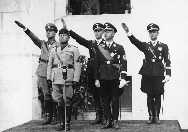 Heinrich Himmler (second from right) with Reinhard Heydrich (third from right) and Benito Mussolini (second from left) at a meeting of the police chiefs of Germany, Yugoslavia, Albania, and Portugal, circa 1938