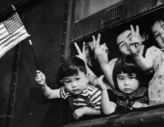 Japanese-Americans being sent to an internment camp during World War II, Seattle, March 1942