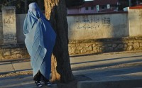 A woman waiting for a taxi, Herat, Afghanistan, February 6, 2012