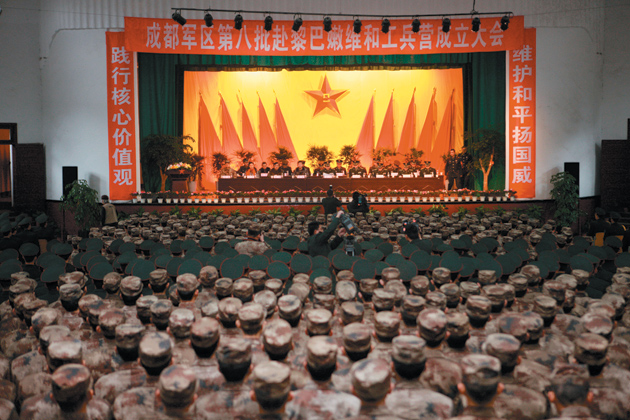 A ceremony in Sichuan Province, China, sending off an engineer battalion of the People's Liberation Army on a peacekeeping mission to Lebanon, January 2011
