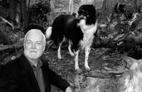 Russell Banks with one of his dogs in the Adirondacks, 2009