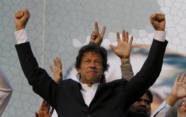 Imran Khan waves to his supporters during a rally in Lahore, Pakistan, October 30, 2011