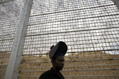 Sudanese immigrant Mohammed Yussef works at the construction site of a border fence along Israel's border with Egypt near the Red Sea resort town of Eilat, February 15, 2012