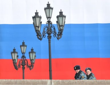 Police officers patrol Manezhnaya Square just outside the Kremlin, Moscow, March 6, 2012