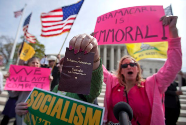 Protesters in front of Supreme Court in Washington as the court concluded three days of arguments on the constitutionality of President Obama's health care overhaul, March 28, 2012