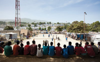 Boys watching a soccer game in Delmas, Haiti, 2010; photograph by Wyatt Gallery from his book <i>Tent Life: Haiti</i>, which collects his portraits of Haitians after the earthquake and includes an essay by Edwidge Danticat. It was published by Umbrage Editions last year.