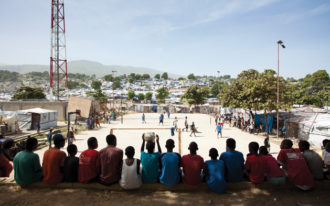 Boys watching a soccer game in Delmas, Haiti, 2010; photograph by Wyatt Gallery from his book Tent Life: Haiti, which collects his portraits of Haitians after the earthquake and includes an essay by Edwidge Danticat. It was published by Umbrage Editions last year.