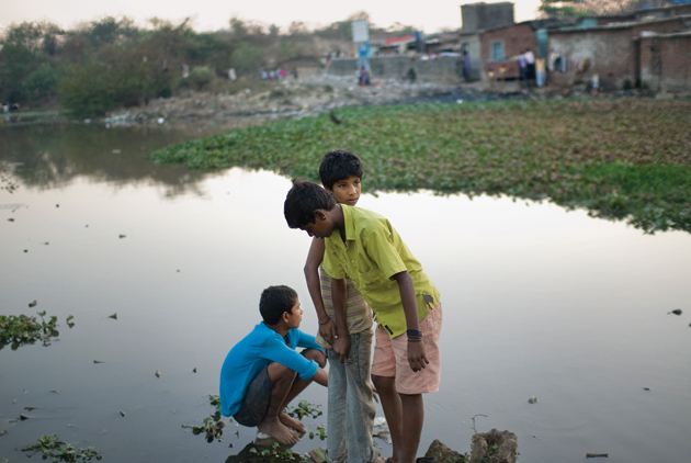 Three boys from the Annawadi slum, one of whom is portrayed in Behind the Beautiful Forevers, February 2009
