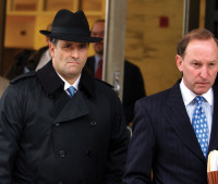 Jack Abramoff (left) leaving a federal courthouse with his attorney, Abbe Lowell, after pleading guilty to felony charges stemming from his lobbying activities, Washington, D.C., January 3, 2006