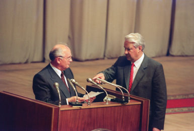 Russian President Boris Yeltsin gesturing toward Soviet President Mikhail Gorbachev during a session of the Russian parliament in Moscow on August 23, 1991, the day after Gorbachev returned to Moscow following the failure of the coup