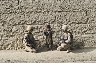 US marines talking to a Pashtun child whose father is a Taliban suspect, Afghanistan, August 17, 2009