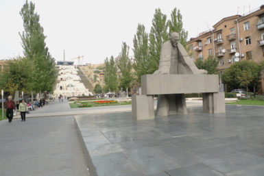 Statue of Alexander Tamanian, the architect of Republic Square and the opera house, in Yerevan, the capital of Armenia, with the city's Cascade staircase in the background