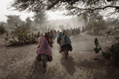 Women in Darfur returning from Kutum market to the Fata Borno camp for internally displaced persons under the protection of African Union soldiers, January 2007; photograph by Gary Knight from Questions Without Answers: The World in Pictures by the Photographers of VII. The book has just been published by Phaidon.