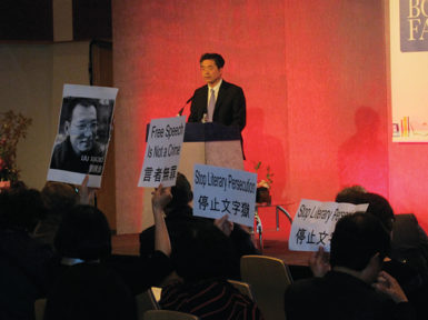 Tibetan, Uighur, and Chinese protesters, one holding up a picture of Liu Xiaobo, at the London Book Fair, April 16, 2012