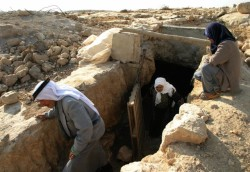 A Palestinian couple inspecting their former cave dwelling in Susya following an earlier expulsion, September 6, 2004