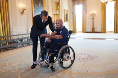 President Obama signing the prosthetic arm of Sergeant Carlos Evans at the White House, March 2012. Evans was injured in Afghanistan during his fourth combat deployment.