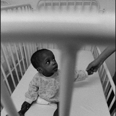 A child in the Phomolong center for AIDS orphans in Tembisa, Johannesburg, 2003