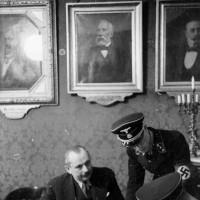 Josef Löwenherz, head of the Israelitische Kultusgemeinde (IKG), Vienna's Jewish community organization, with SS officers at the IKG offices, March 18, 1938