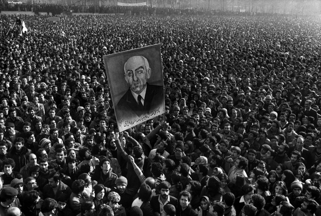 A portrait of Muhammad Mossadegh held above thousands of protesters at Tehran University during the Iranian Revolution, January 1979
