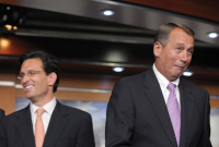 House Speaker John Boehner (right), after mistakenly thinking that the first question in a news conference was for him, Washington, D.C., July 14, 2011. The question was for House Majority Leader Eric Cantor (left).