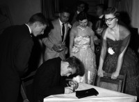 James Dean signing autographs during a Valentine's Day dance at his old high school, Fairmount, Indiana, 1955