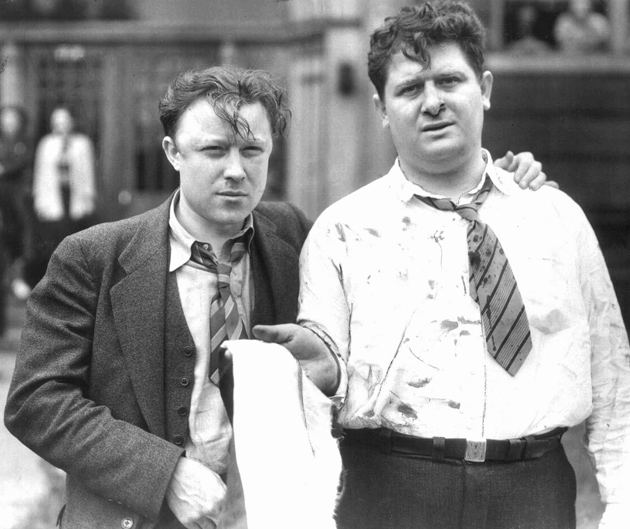 Walter Reuther, left, future president of the United Auto Workers, with Richard -Frankensteen following their beating by Ford Motor Company security men in the 'Battle of the Overpass,' at the Ford Rouge factory in Dearborn, Michigan, May 26, 1937. Reuther, while strongly anti-Communist, worked closely with, and also opposed, UAW activists such as Frankensteen who were cooperating with the Communist Party of the USA at the time.