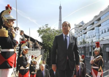 French President François Hollande, center, arrives at the Jewish memorial prior to ceremonies to mark the commemoration of the 70th anniversary of the Vel d'Hiv roundup, Paris, July 22, 2012